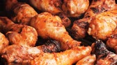 ínyenc : UHD shot of the marinated chicken drumsticks on the grill