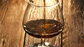koňak : Cinematic 1080p tilt up shot of cognac pouring into the glass