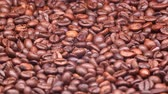 turntable : UHD closeup shot of the medium roasted coffee beans on a turntable Stock Footage