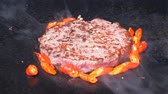 котлета : UHD closeup shot of the delicious premium beef burger being fried with hot red peppers