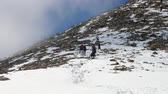 alpinista : group of tourists team returns from a difficult trek to the mountains in winter