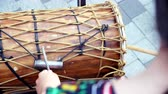 djembe : Close up POV. Playing drumming on africam jembe drum with drumsticks Slow motion Stock Footage