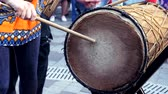 gruppo musicale : Man beats a huge cow drum with a big drumstick in slow motion. Summer evening