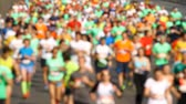 Blurred mass of marathon out runners people