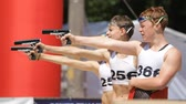 atirador : KIEV, UKRAINE - JUNE 25, 2016: Competitions with shooting from a pneumatic pistol, running and swimming ( Triatman)young men and girl in Kiev, Ukraine.