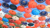 Decorative umbrellas hanging against the blue sky