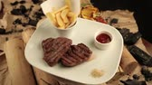 fritar : Steak with fries and sauce on firewoods