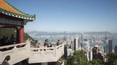 weather : Hong Kong, Hong Kong S.A.R. - January 20, 2017: Tourists at the Lions Pavilion at the Victoria Peak, Hong Kong. 4k timelapse.
