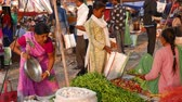 tribo : Mandu, India - December 2, 2017: Saturday market at Mandu, Madhya Pradesh, India. Tribal people gather here once a week from the villages of the Bastar region Stock Footage