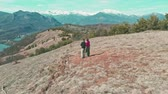 Aerial view of the mountains, backpackers walking outdoors, panoramic view, inspiring travel and freedom