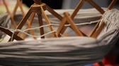 meada : old spinning wheel that turns into a skein of wool for the artisan tailoring