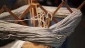 orsó : ancient wooden spinning wheel that turns to create a skein of wool Stock mozgókép