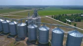 Aerial shot of industrial farm silos on farmland
