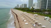 Aerial summer lounge chairs in Miami Beach South 4k