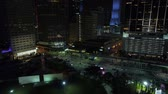 establishing shot : Night aerial approach Miami Metrorail Downtown Stock Footage