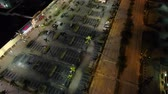 Night aerial drone over a shopping plaza parking lot
