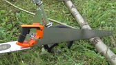 handy : Scooter attached to it a saw sawing a log Stock Footage