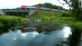 bridge across the river : The train rides on the bridge across the river Stock Footage