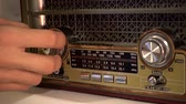 sepia : Adjusting the volume knob of the retro radio