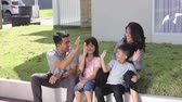parente : happy asian family in front of their house Vídeos