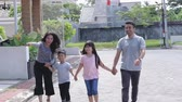 относительный : young happy asian family walking together