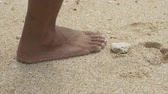 коралловый : step of man walking on beach sand making a footprint