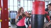Boxer training in the gym with trainer
