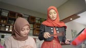 eid celebration : Two woman hijab make some cuisine to serve when breaking fast