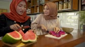 fast food : Two asian woman hijab prepare some fruits to make cocktail