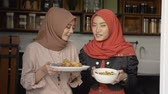 Two woman hijab make some cuisine to serve when breaking fast