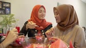 hijab women and friends breaking fast