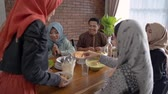 scarf : The muslim family together enjoy the iftar meal