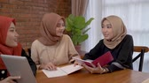 muslim woman using tablet with friend together Stockvideo