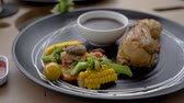 half chicken grill served with mushroom sauce