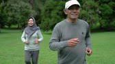life is good : couple doing exercising by running in the garden