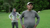 life is good : asian muslim senior couple exercising together