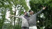 life is good : senior couple close their eyes and enjoying nature