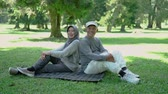 life is good : muslim couple in the park smiling and looking at camera Stock Footage