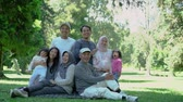 life is good : family with parent, grandparent and grandchildren together