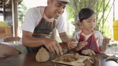 krug : asian father and daughter making pottery