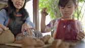 shaping : mother and daughter making ceramic pot Stock Footage