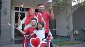 augusztus : family decorating bicycle with flag and bow for indonesia independence day
