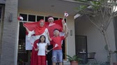 augusztus : family celebrating indonesian independence day together carrying flag Stock mozgókép