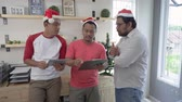 malajsky : asian worker team working in the office during christmas