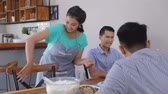 妻 : pretty asian wife preparing lunch 動画素材
