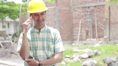 ziegel : construction worker using mobile phone