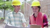 ziegel : two construction worker standing in the building site Videos