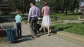 pram : Family summer walking in a green park. Stock Footage