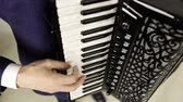 accordionist : The accordionist plays a sensual piece on an expensive accordion.
