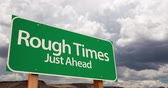 4K Time-lapse Rough Times Green Road Sign and Stormy Cumulus Clouds and Rain. Wideo